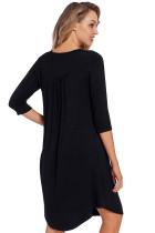 Zwarte jurk met tuniek en tuniek