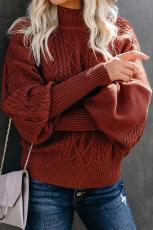Roter Housewarming-Pullover mit Zopfmuster und Ballonärmeln