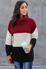 Czarny sweter z golfem w kolorowe bloki