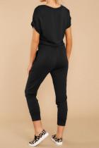 Schwarze Jumpsuits mit V-Ausschnitt und Wickelfront