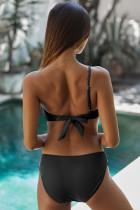 Schwarzer Badeanzug mit einer Schulter und Rüschen