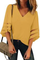 Luźna bluzka z dekoltem w serek i żółtym rękawem