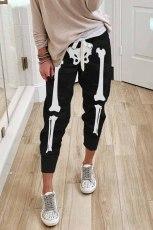 Zwarte joggingbroek met elastische taille en trekkoord in Halloween-schedelprint
