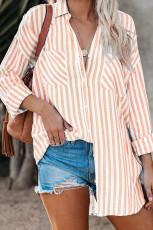 Blouse met knoopsluiting en knoopsluiting in oranje gestreept linnen