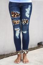 Blauwe uitgeholde luipaard splice gescheurde jeans