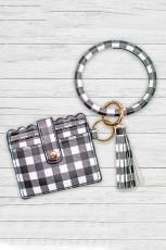 Черная кожаная сумка с кисточками и цепочкой для ключей в клетку