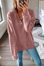 Kaus kerah zip merah muda