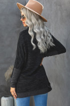 Top estilo túnica con abertura lateral y manga murciélago de cuello alto negro