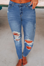 Raw-cut gerafelde zoom jeans met medium wassing