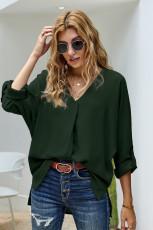 Groen shirt met V-hals, 3/4 mouwen en hoge lage zoom