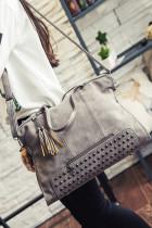 Bolsa com tachas vintage cinza