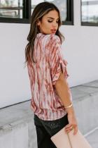 Blusa de manga corta con bolsillo estampado naranja
