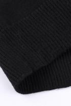 Черный вязаный свитер с леопардовым принтом и открытыми плечами