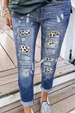 Jeans strappati con stampa leopardata