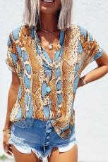 Losvallende blouse met slangenleerprint
