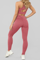 Conjunto de leotardos y sujetador deportivo rosa cruzado