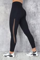 Czarne legginsy sportowe do jogi z wysokim stanem i kieszenią na telefon