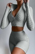 Szara, dwuczęściowa, solidna odzież sportowa z zamkiem błyskawicznym