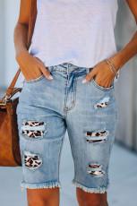 กางเกงขาสั้นเดนิมเบอร์มิวด้าแบบฉีกขาดกลางเอว