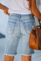Bermuda in denim con patch scozzesi strappati a vita media