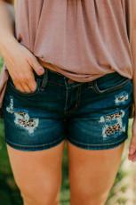 Ciemnoniebieskie szorty dżinsowe z naszywkami w panterkę