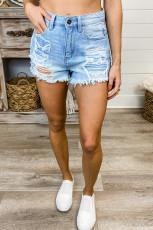Niebieskie spodenki jeansowe z odcięciem